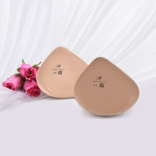 Features an atypical asymmetric footprint with an average profile in the bra cup. It can be positioned to war on either side of the body. Also features an extension that is angled inward to provide medial fullness that minimizes the gap between the bra and the chest wall. The flowable gel back contours to the chest wall for a comfortable fit.