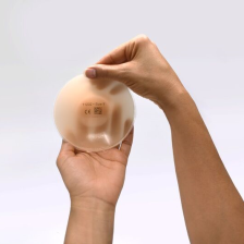 Features a round shape that closely resembles the apex of a natural breast, to prevent shifting in the bra cup
