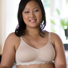 Designed with a thin layer of foam for a smooth, enhanced silhouette & microfiber fabric for a sleek design and cooling comfort. Lace accent across the band adds a bit of flair & femininity. Bra features convertible, stretch straps that can be worn as criss-cross or halter style. Average profile.
