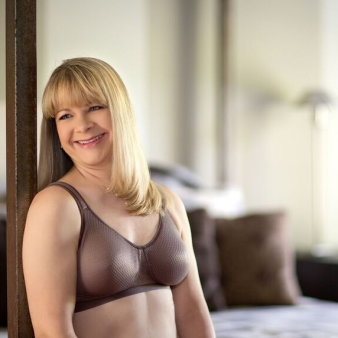Constructed with textured fabric that provides a cool, comfortable massage- like wear experience. Padded, stretch straps & a wide, elastic band provides comfortable & supportive fit. Average to full profile.