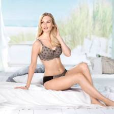 Concealing soft cup bra with pockets made of delicate, breathable tulle.